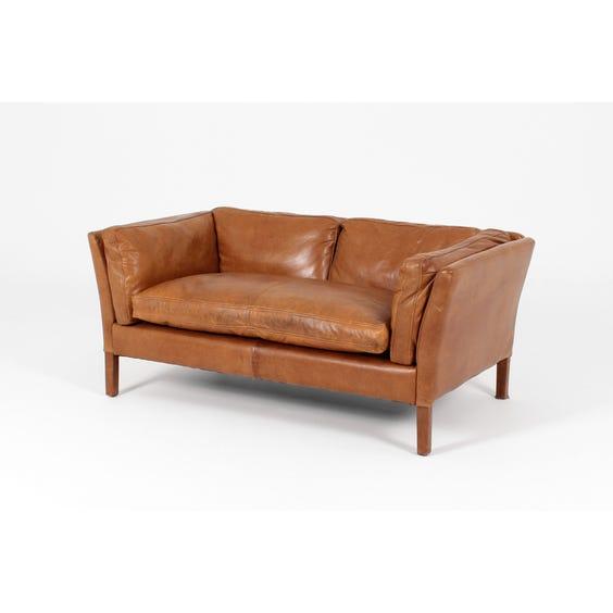 Small tan leather sofa image