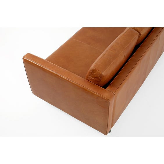 Tan leather three seater sofa image