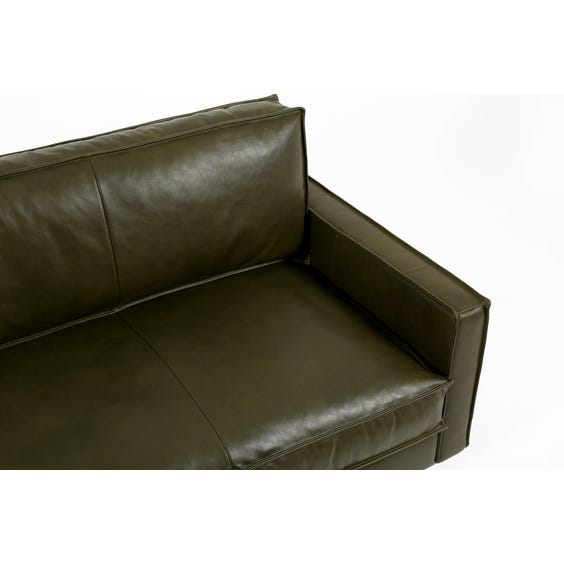 Green leather four seater sofa image
