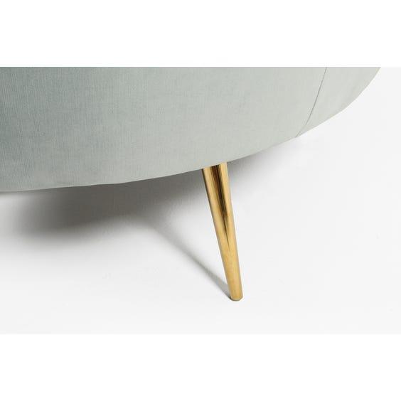 Large muted aqua curved sofa image