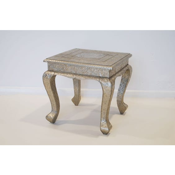 Ornate beaten metal silver table image