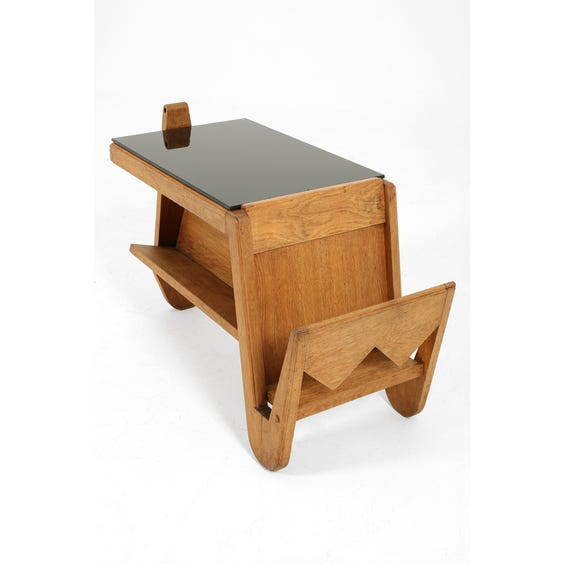 Sculptural oak side table with end magazine rack image