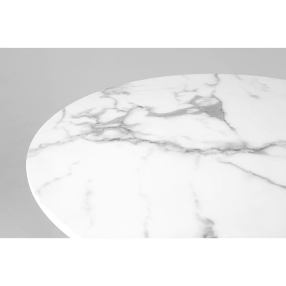 Veined faux marble circular table image