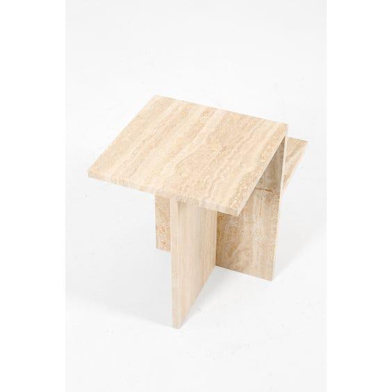 Sculptural travertine side table image