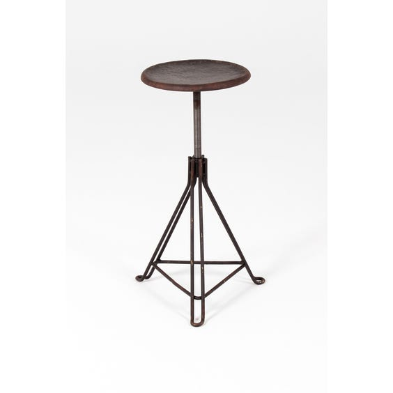 Industrial black metal rusted stool image