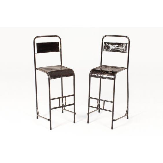 Assorted worn black metal tall stool image