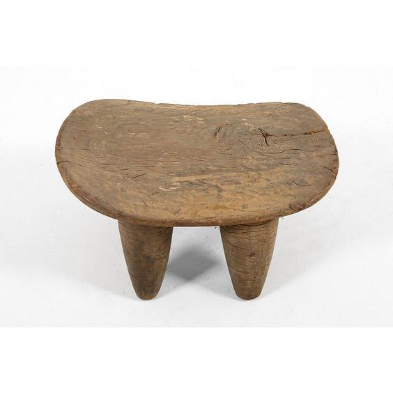 Primitive carved wooden stool image