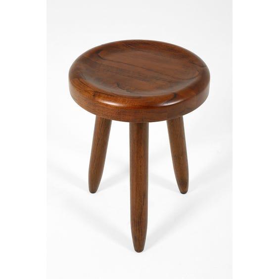 Solid dark wood milking stool image