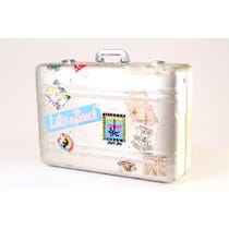 Vintage metal suitcase with stickers