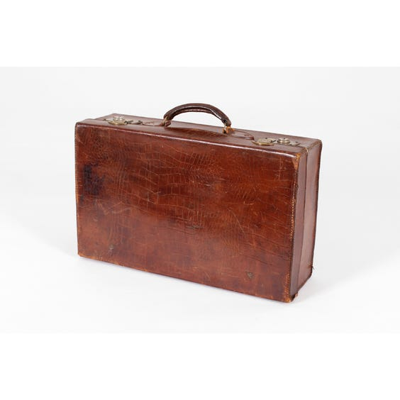 Period distressed crocodile effect suitcase image