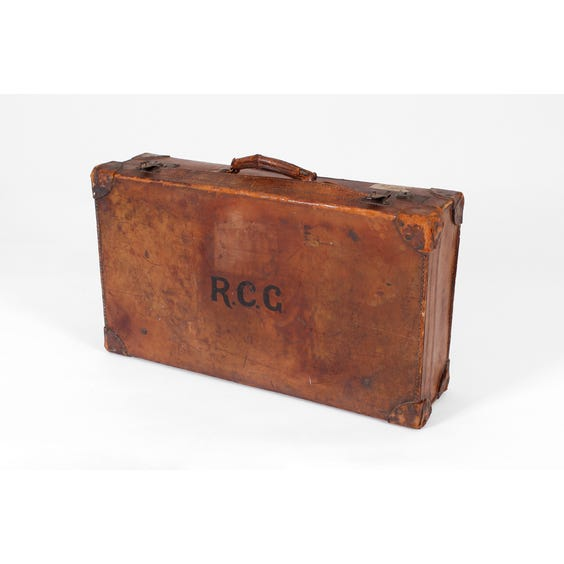 Period distressed brown leather suitcase image