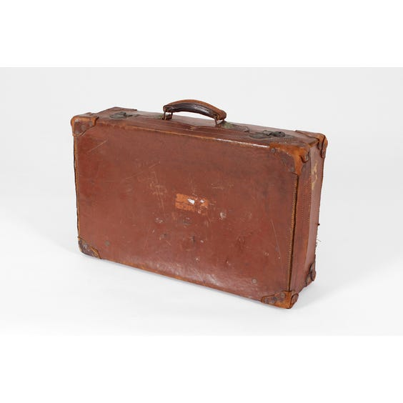 Distressed brown leather suitcase image