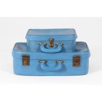 Two blue vintage vinyl suitcases
