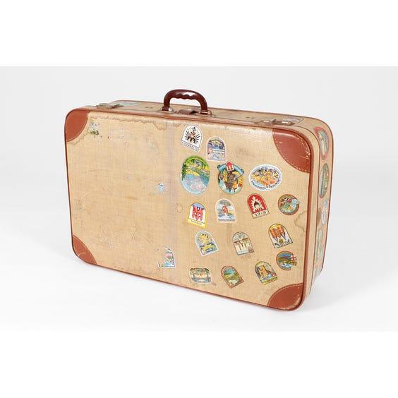 Vintage distressed cream tan suitcase image