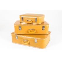 Three vintage mustard vinyl suitcases