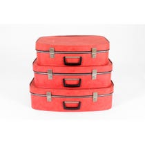 Three vintage red vinyl suitcases