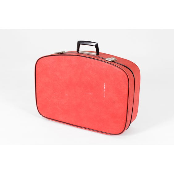 Small red vinyl suitcase image