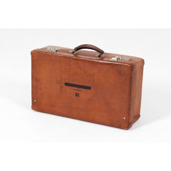 Vintage tan leather suitcase image