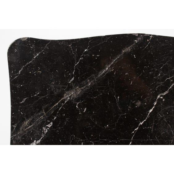 Black marble surface waved edge image
