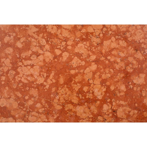 Pink and terracotta marble surface image
