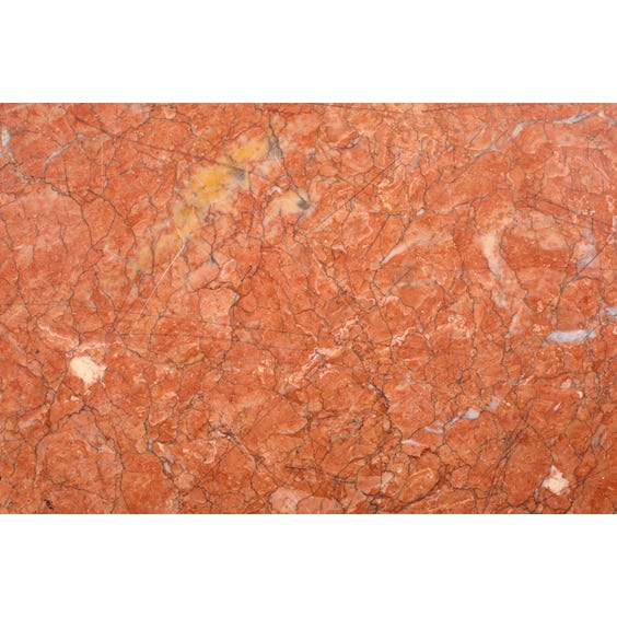 Heavily veined pink marble surface image