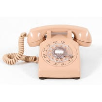 Flesh coloured vintage telephone