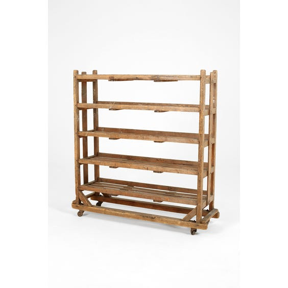 Rustic antique bakers rack image