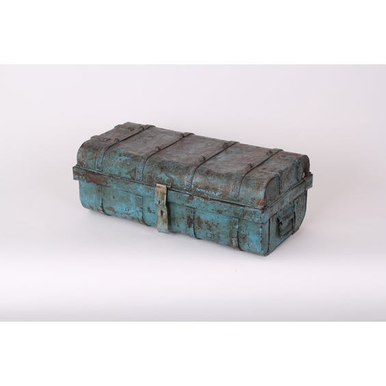 Distressed turquoise painted metal trunk image