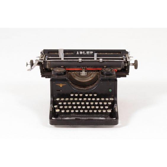 Distressed black Adler typewriter image