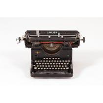 Distressed black Adler typewriter