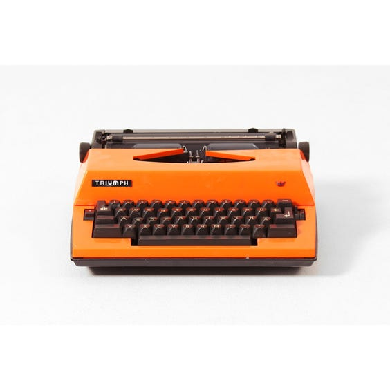 Vintage orange Triumph typewriter image